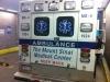 """Rückseite \""""meines\"""" Rettungswagens 12-G (rechts steht Joe, einer der Sanitäter)"""