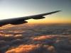 Erste Sonnenstrahlen auf den Wolken